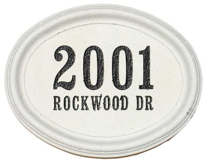 Engraved oval cast concrete address block